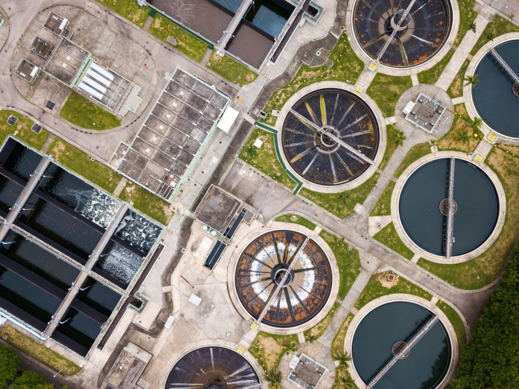an overhead shot of a wastewater treatment plant